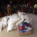 A donation of food and school supplies to orphaned children in Coya-Guinea